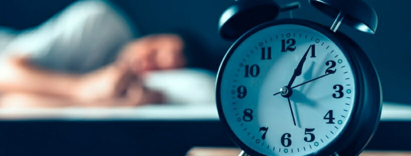 Alarm clock with a man in the background