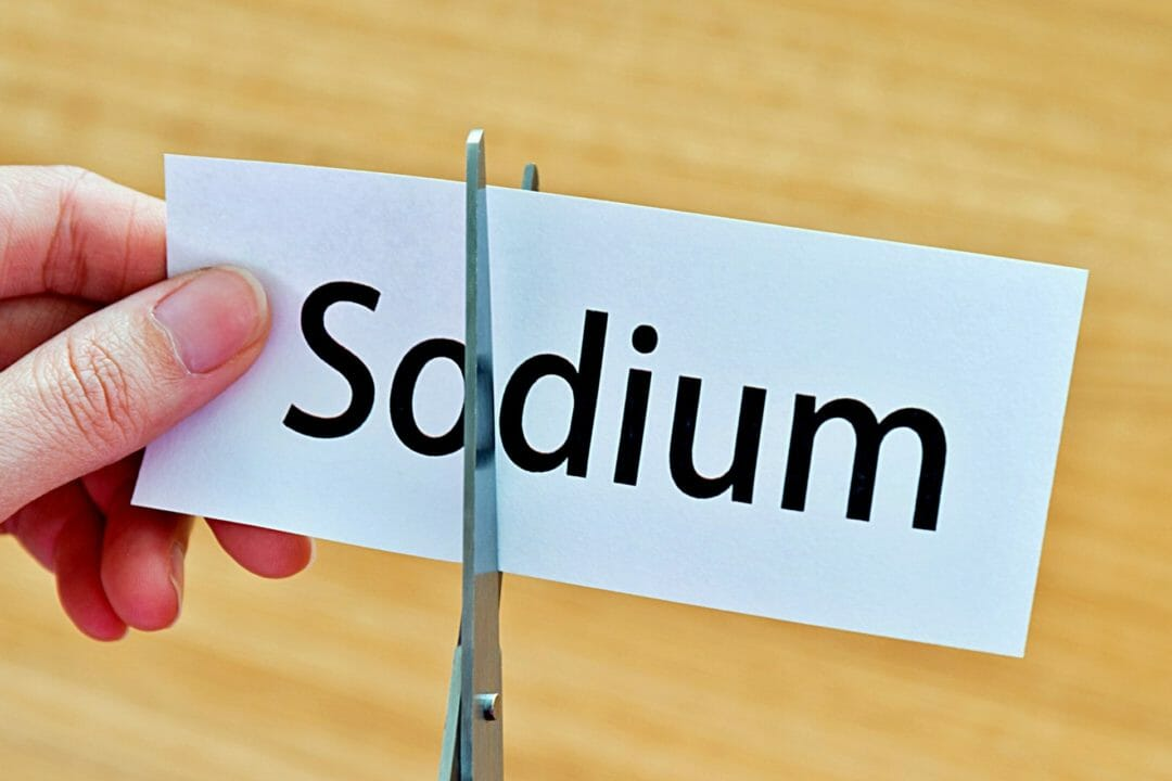 sodium word cut in paper