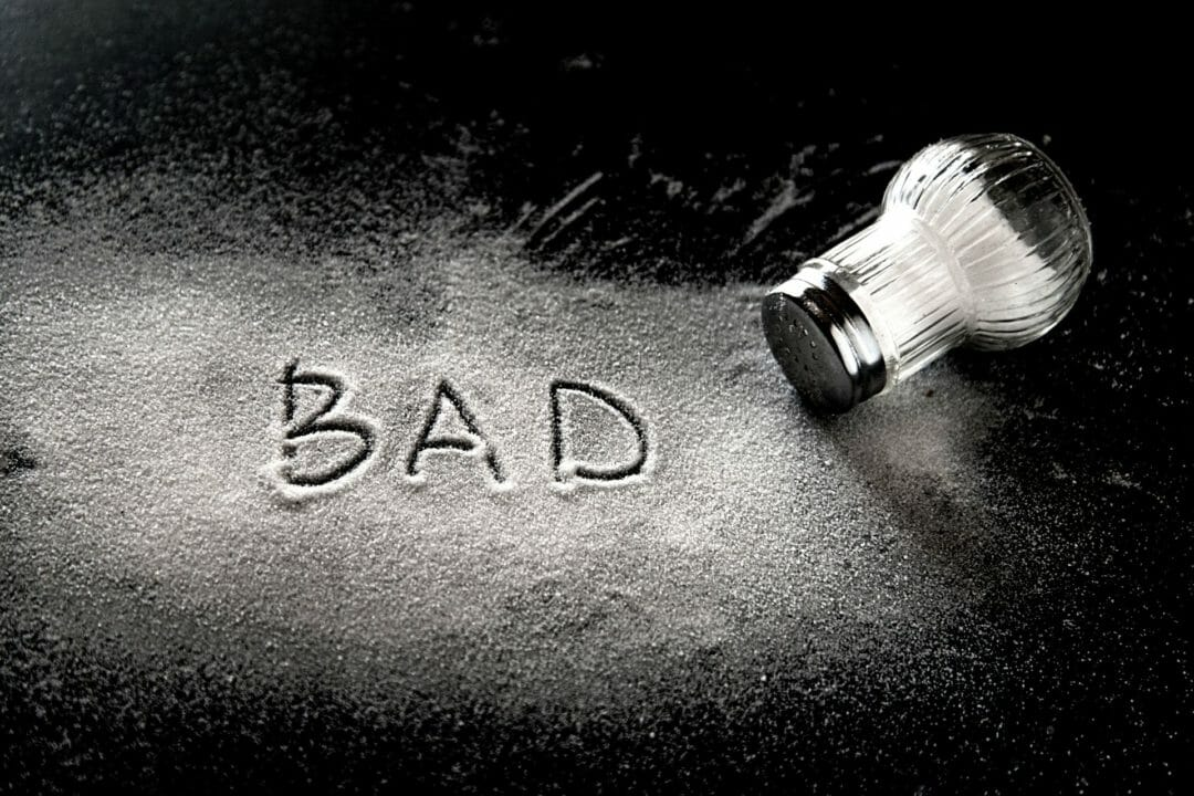 the word bad spelled out in salt